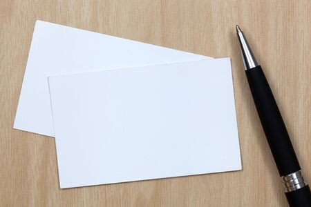 business card on table with pen