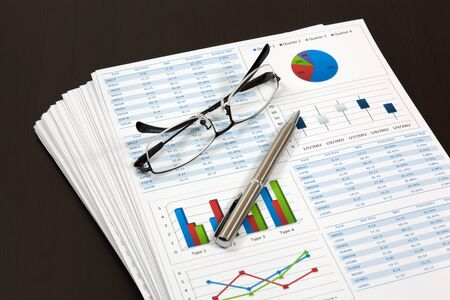 Graphs and Charts Report with pen Stock Photo - 18591445