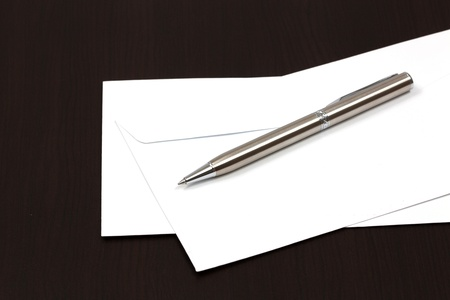 envelopes on a table with pen photo