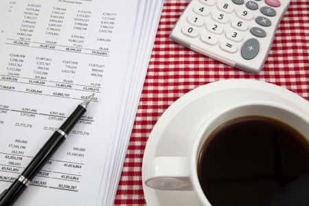 Business report and cup of coffee photo
