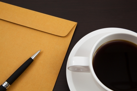 Cup of coffee and paper photo