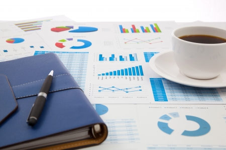 strategic focus: Business report with cup of coffee