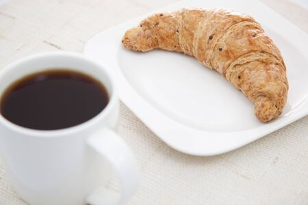 Croissant and a cup of coffee photo
