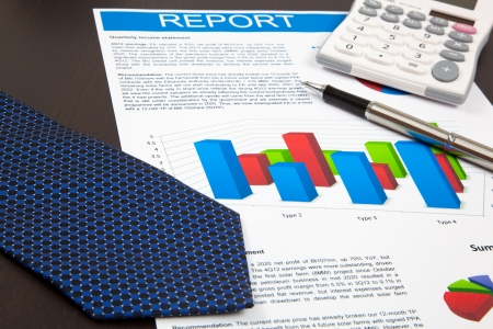 Financial graphs and charts on table photo