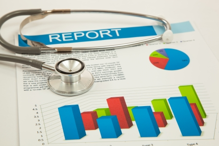 Financial charts and graphs with Stethoscope photo