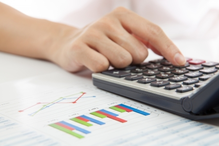 woman hand with calculator and business report Stock Photo - 21411043