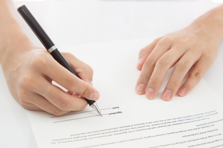 testimony: Female hand signing contract. Stock Photo
