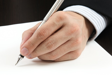 test deadline: Business man writing something on the paper