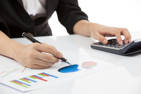 woman hand with calculator and business report photo