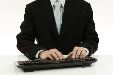 man's hand on computer keyboard photo