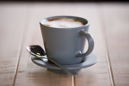 A cup of coffee on wooden photo