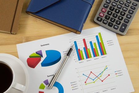 worktable: Worktable covered with business report Stock Photo