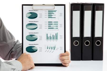 Graphs and charts analyzed by businessman photo