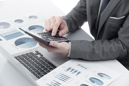 analyzed: Graphs and charts analyzed by businessman on table Stock Photo
