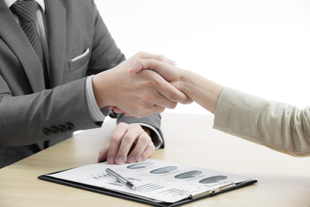 Business handshake and business people with Business Report Stock Photo