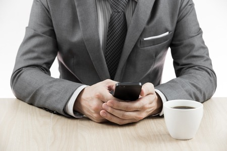 Businessman makes coffee break. Close up photo