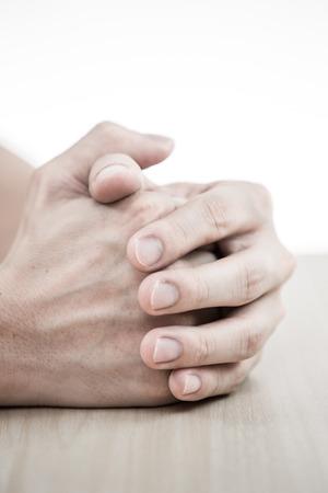hands man praying on table