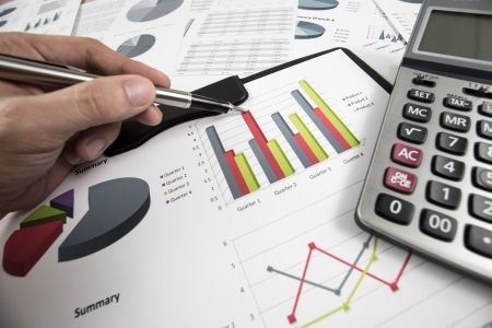 man hand with pen and business report Stock Photo