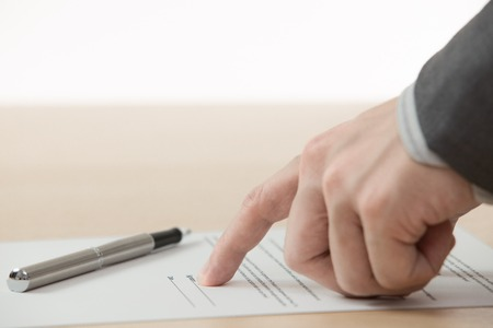 Business man signing finance contract on table photo