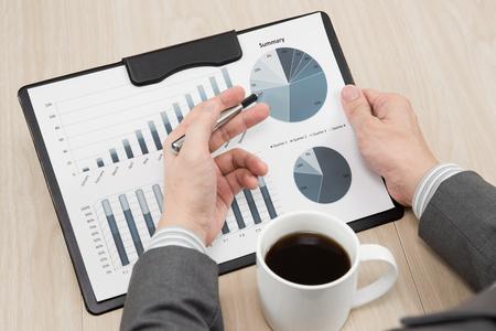 analyzed: graphs and charts analyzed by businessman