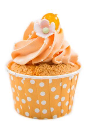Tasty cupcake with butter cream on white background photo