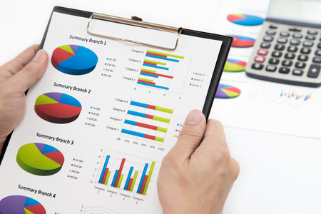 Stock market graphs monitoring with pen Stock Photo