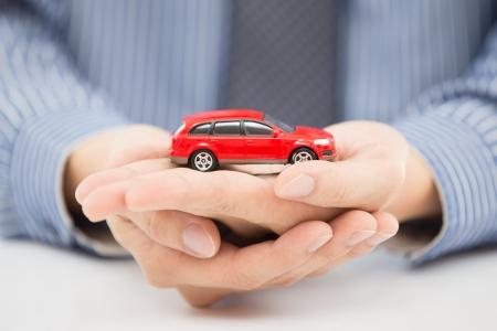 man hand with holding red car Stock Photo