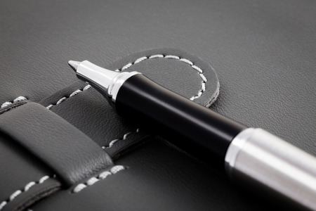 Business concept with notebook and pen photo