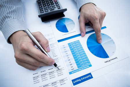 man hand with pen and business report. Accounting Stock Photo