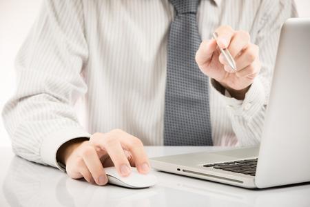 Close-up of Businessman using laptop photo