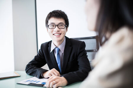 asian businessman: Successful young business executives meeting at the office.Asian Stock Photo