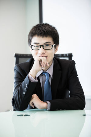 Image of young handsome confident businessman in suit.Asian photo