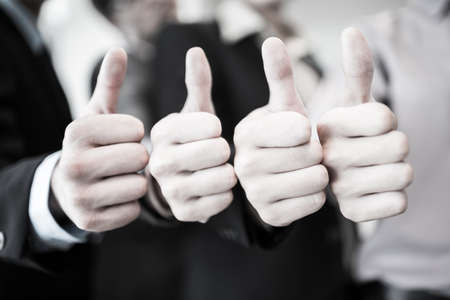 Group of hands with thumbs up expressing positivity.Asian photo