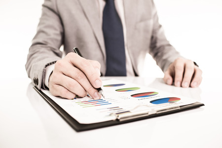 Businessman analyzing investment charts with laptop. Accounting photo
