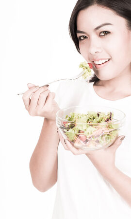 portrait of a lovely young woman eating healthy photo