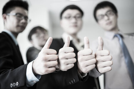 thumbsup: Group of hands with thumbs up expressing positivity.Asian