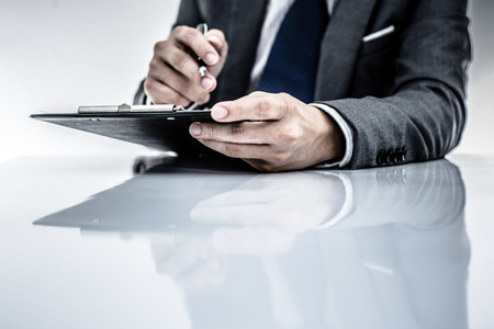 business report and man hand. Accounting Stock Photo