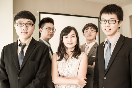 asian business people: Group of business people with businessman leader on foreground.Asian