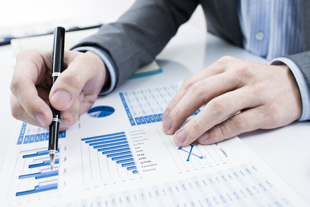investing risk: Businessman analyzing investment charts. Accounting