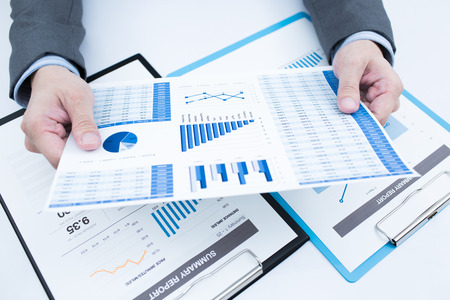 analyzed: Close-up of graphs and charts analyzed by businessman