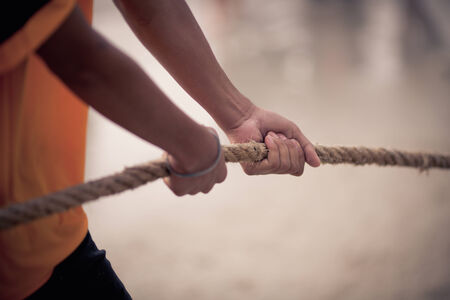 woman hard working: Rope pulling - Tug of War