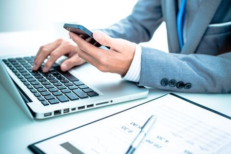 audit: business, technology and internet concept - close up of man hands with coffee and laptop computer
