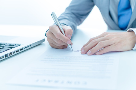 businessman signing documents: Business man signing a contract Stock Photo