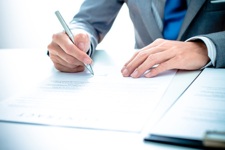 signing a contract: Business man signing a contract Stock Photo