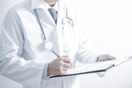 filling in: Close-up of male hands filling in medical form Stock Photo