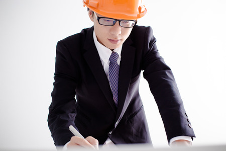 construction project: Architect sketching a construction project Stock Photo