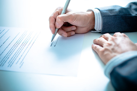 loans: Business man signing a contract Stock Photo