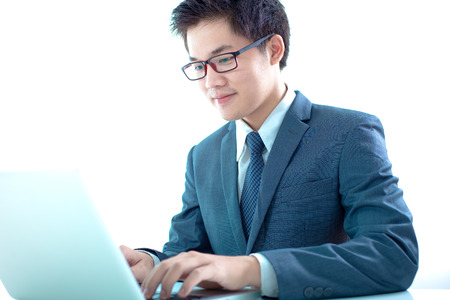 busy beard: Handsome businessman working with laptop