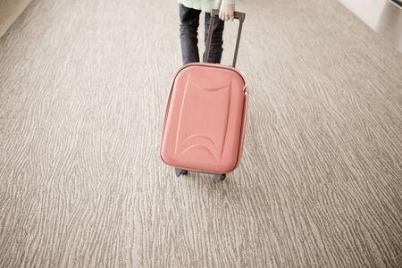 travel luggage: passenger walking in airport Stock Photo