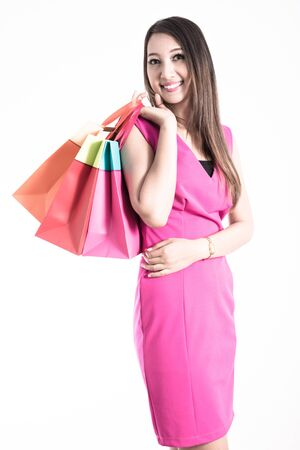 Shopping woman holding shopping bags photo